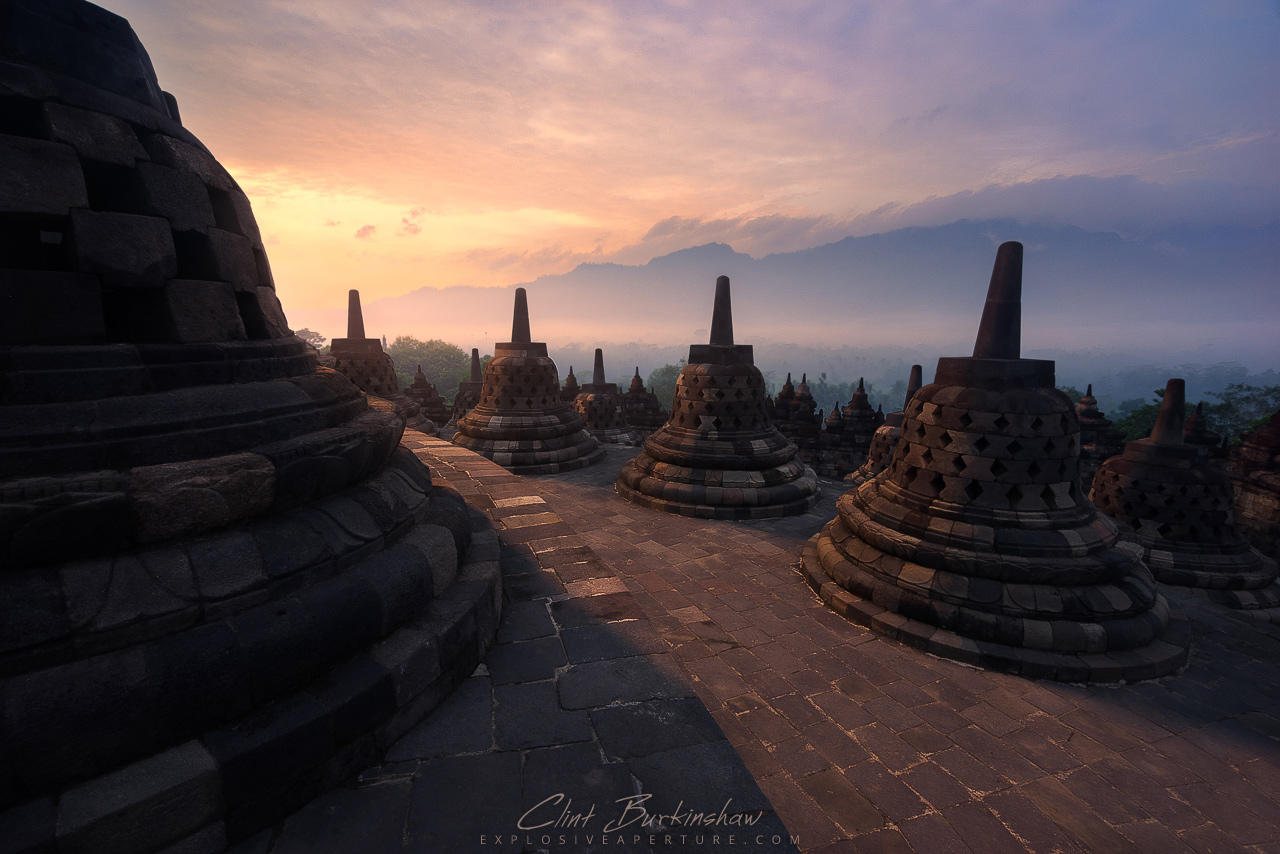 Sunrise through the mist of Borobudur Temple